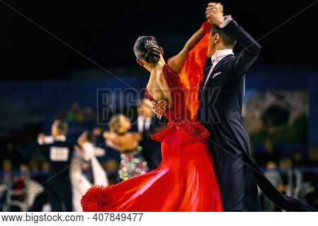 сouple Dancers Man And Woman Waltz Dancing In Competition