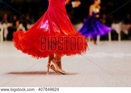 Female Dancer In Red Ball Gown For Dance Competition