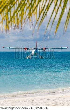 Sea Plane At Tropical Beach Resort. Luxury Summer Travel Destination With Seaplane In Maldives Islan