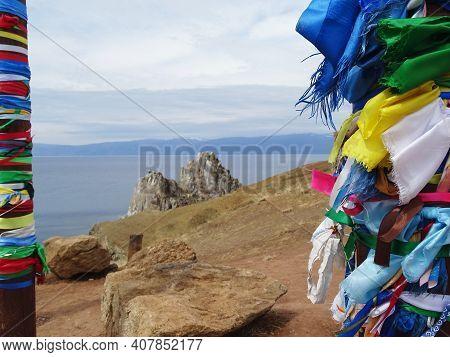 Buryat Traditional Pagan Holy Poles With Colorful Ribbons By The Lake Baikal