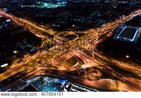 Car Traffic Transport On Multiple Lane Highway Or Winding Road Expressway In Asia City At Night, Dro