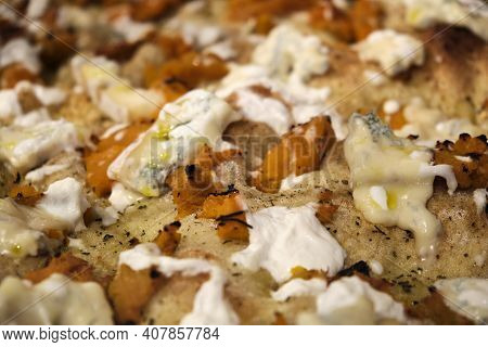 Macrophotography Of A Slice Of Italian Pizza With Pumpkin And Gorgonzola. High Quality Photo