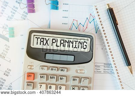 Tax Planning Word On Calculator. Business And Tax Concept. Time To Pay Tax In Year.