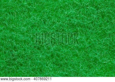 Green Sponge Texture. Closeup Of The Rough Side Of A Kitchen Sponge For Cleaning Of Of Pots And Pans