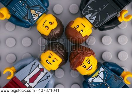 Tambov, Russian Federation - January 17, 2021 Four Lego Businesspeople Minifigures On Gray Baseplate