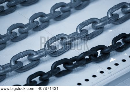 The Line Of  Steel Chain Spare Part. The Spare Parts Of Industrial Part.