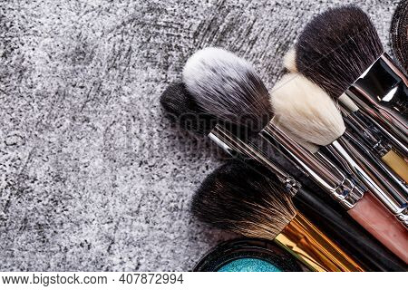 Professional Makeup Brushes And Tools, Makeup Product Set.a Set Of Decorative Cosmetics On A Gray Ba