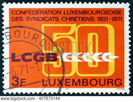 Luxembourg - Circa 1971: A Stamp Printed In Luxembourg Dedicated To Christian Workers Union, 50th An