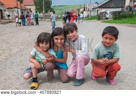 05-16-2018. Lomnicka, Slovakia. A Close-up Of A Roma Or Gypsy Group Of Children Hugging And Smiling