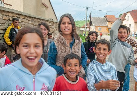 05-16-2018. Lomnicka, Slovakia. A Close-up Of A Roma Or Gypsy Group Of Children Smiling In An Abando