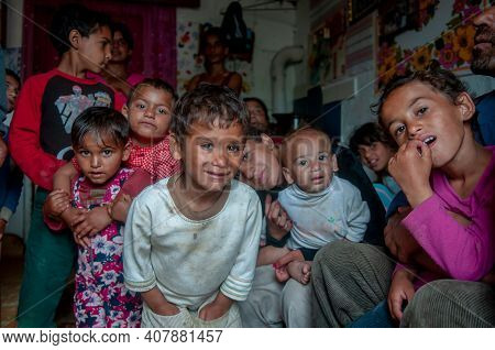 5-16-2018. Lomnicka, Slovakia. A Close-up Of A Roma Or Gypsy Family Packed In A Small Deteriorated H