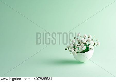 Gypsophila Flowers In Eggshell On A Green Background, Close Up. Easter Background.