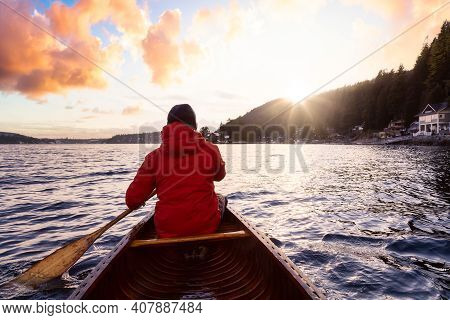 Adventure Man On A Wooden Canoe Is Paddling In The Ocean. Dramatic Sunset Sky Art Render. Taken In I