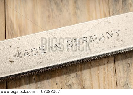 Made In Germany Engraved On Steel Tool On Wooden Table. Close Up