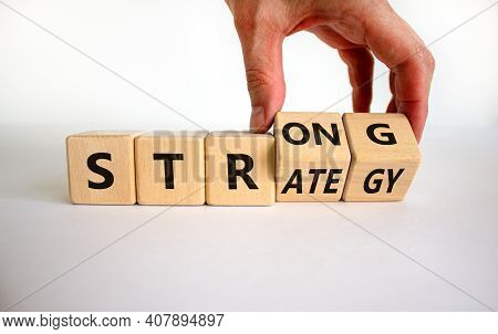 Strong Strategy Symbol. Businessman Turns Wooden Cubes With Words 'strong Strategy'. Beautiful White