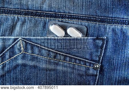 Pills In Jeans Pocket. Blister Pack Of White Pills In Back Jeans Pocket. Care Health Concept