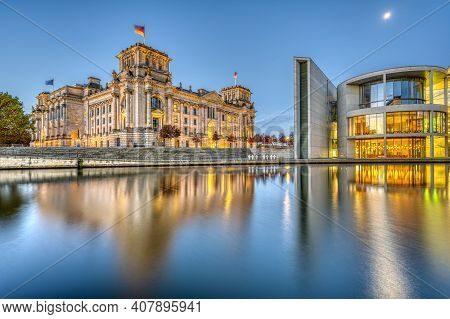 The Reichstag And Part Of The Paul-loebe-haus At The River Spree In Berlin At Twilight