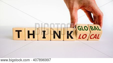 Think Local Or Global Concept. Businessman Turns Wooden Cubes, Changes Words 'think Local' To 'think