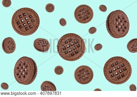 Round Chocolate Cookies On A Mint Background. Falling Cookies. Cookies Background