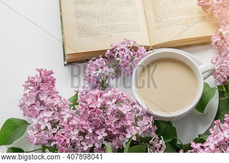 Spring Cozy Composition Flat Lay Coffee Cup, Book, Lilac Branches, Spring Season Concept