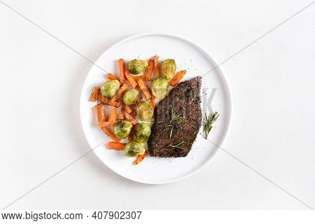 Grilled Beef Steak With Brussels Sprouts And Sweet Potatoes On Plate Over White Background With Free