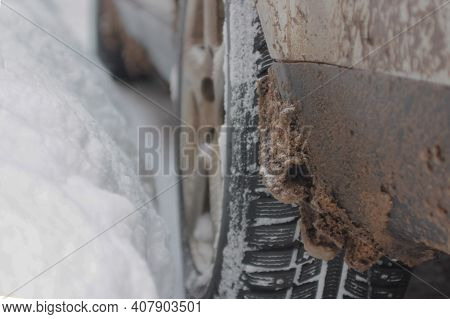 Dirty Mud Guard. Frozen Salt And Snow On The Mudguard Of The Car