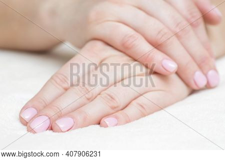 Closeup View Of Beautiful Female Hands On Towel. Beautiful Female Hands  On Towel. Hand Care. Woman