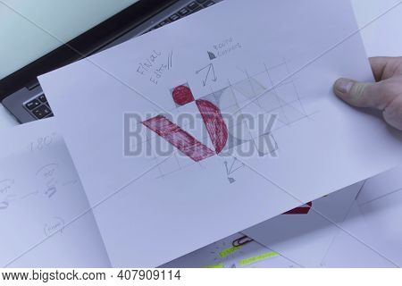 Creative Workplace Of A Graphic Designer. A Man In The Office Is Developing A Logo On The Table Agai