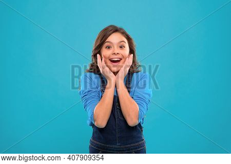 Sincere Excitement. Kid Girl Long Healthy Shiny Hair Wear Casual Clothes. Little Girl Excited Happy