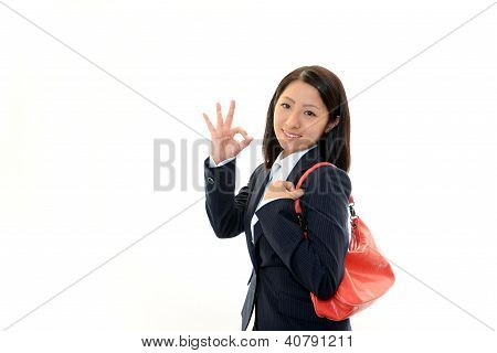 Smiling young woman holding a shoulder bag