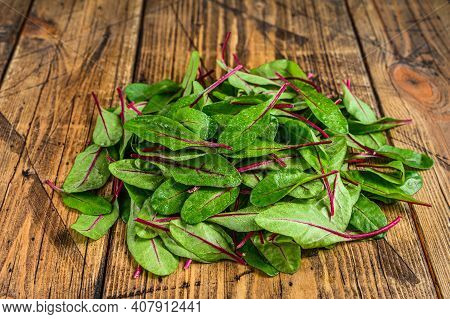 Fresh Raw Chard Leaves, Mangold, Swiss Chard On A Wooden Kitchen Table. Wooden Background. Top View