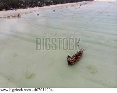 Aerial Shot Low Tide In Paje And Jambiani On Zanzibar, Tanzania. Stranded Ships On A Shallow Indian
