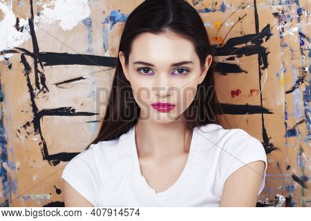 Young Brunette Woman With Fashion Makeup On Painted Background, Lifestyle People Concept