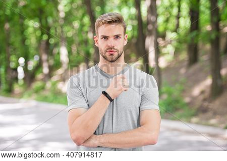 Man Athlete On Strict Face Posing With Sportive Equipment, Nature Background. Athlete With Bristle W
