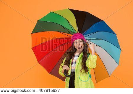 Positivity Concept. Rainy Day Fun. Happy Walk Under Umbrella. Enjoy Rain Concept. Kid Girl Happy Hol