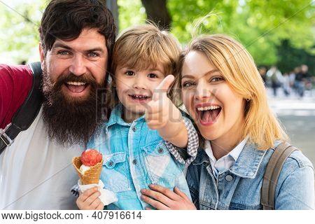 Family Eat Icecream Outdoor. Junk Food. Delicious Summer Ice Cream