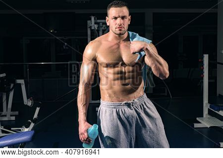 Sport Health. Stay Hydrated Concept. Weightlifter Gym Man Preparing For Training. Muscular Athletic
