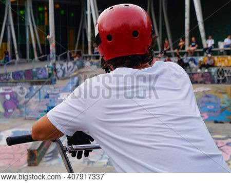 Man In White T-shirt Waiting For His Turn At The Skatepark