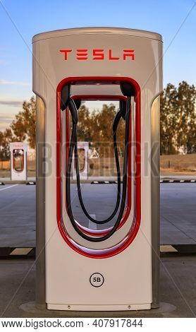 Firebaugh, Usa - January 21, 2021: Empty Electric Tesla Superchargers By California Highway 5