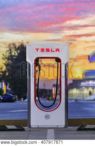 Firebaugh, Usa - January 21, 2021: Empty Electric Tesla Supercharger By California Highway 5 At Suns