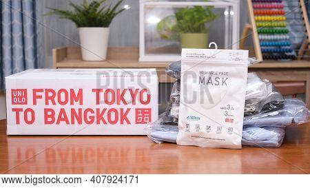 Bangkok, Thailand - Febuary 11, 2021: Uniqlo Washable Face Mask Package Near Cardboard Box Package D