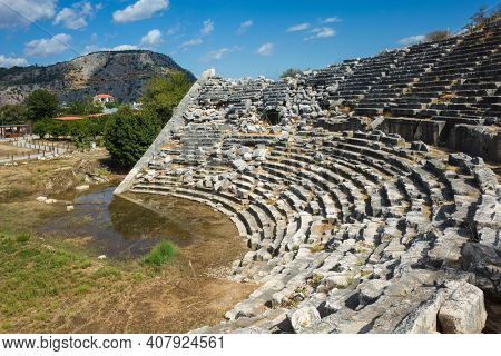 Ruins of Theatre in Letoon Ancient City in village Kumluova, Turkey. Sunny day, Greek culture ancient amphitheater architecture