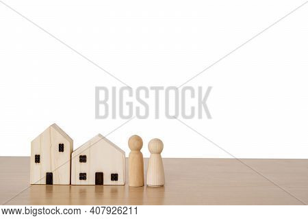 Wood Doll Couple Lover Stand In Near House Model Isolated White Background, Self-quarantine And Stay