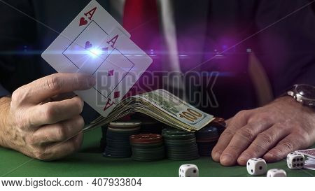 Businessman At Green Playing Table With Gambling Chips And Cards Playing Poker And Blackjack In Casi