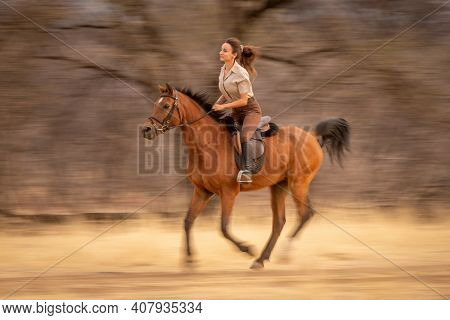 Slow Pan Of Brunette Riding In Woods