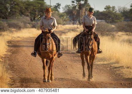 Smiling Blonde And Brunette Ride Along Track