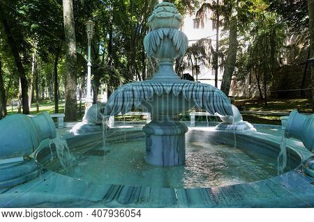 Marble Fountain In The City Park Of Istanbul. Made In The Form Of A Flower On A Stem, With Graceful