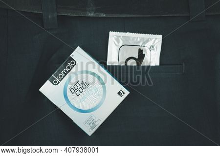 Samut Prakan, Thailand - February 13, 2021 : Box Of Okamoto Dot De Cool Condom 52mm In Man Blue Slac