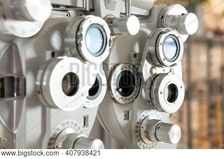 Selective Focus At Optometry Frame Equipment. With Blurred Background While Optometrist Examine Eye