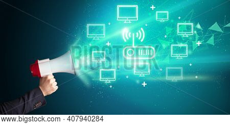 Young person yelling in loudspeaker with wireless technology icon, modern technology concept